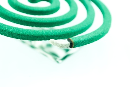 mozzie: Smoke spiral usable against mosquitoes and other insects - Burning mosquito coil as anti insect Stock Photo