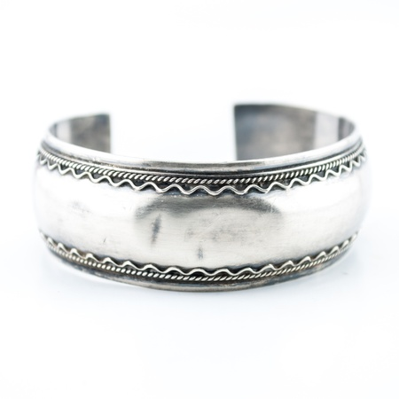 Silver old vintage bracelet isolated on white background Stock Photo