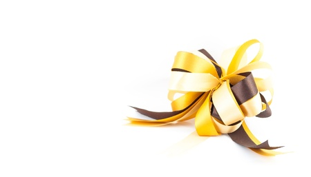 golden or yellow ribbon bow isolated on white background Stock Photo - 20599282