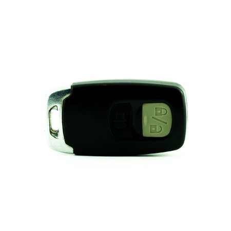Car key with remote buttons on white background photo