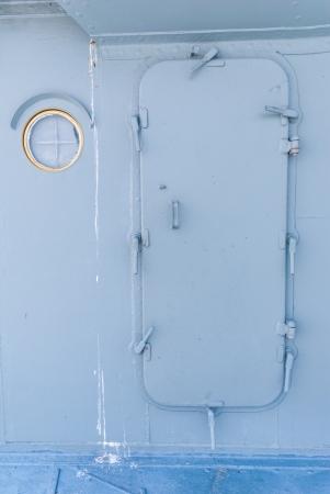 a battleship: Battleship door with steel porthole of ship