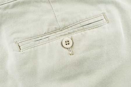 Close up of trousers - Pocket on pants with botton, detail photo