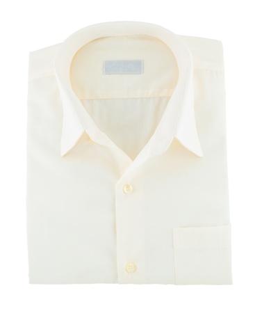 yellow folded shirt isolated on white background photo