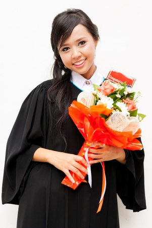 College degree. Happy young women in robe photo