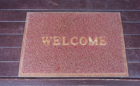 Used welcome carpet mat, welcome doormat carpet on the floor Stock Photo - 21566072