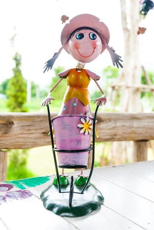 Cute smile doll with a beautiful basket on dining table photo