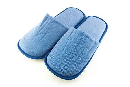 Household blue slippers isolated on white background Stock Photo