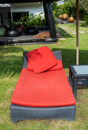 Close up beach red chair bed near the swimming pool photo