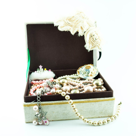 jewelry box with jewelry  - Treasure of pearls on white photo