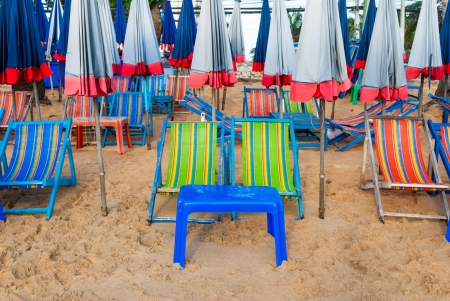 Beach chairs and umbrella on the beach photo