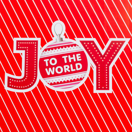 Design of joy to the world text on red background