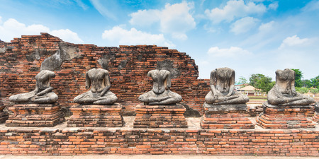 Broken Buddha statue at Ayuttaya, Thailand photo