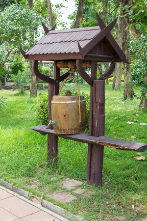Wooden barrels for water storage in the garden photo