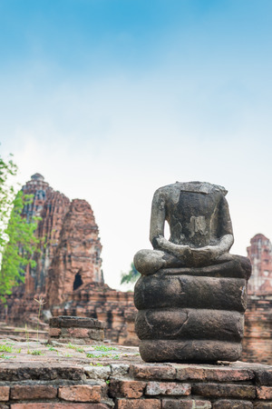 Ruins of ancient broken buddha at Ayuttaya, Thailand photo