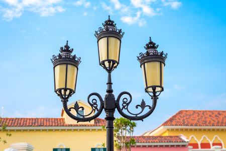 Vintage lamppost,streetlight in the city town against blue sky photo