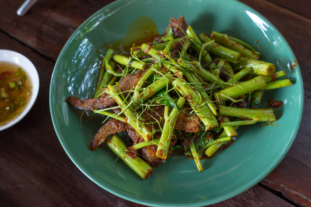 fried green morning glory with fish meat, Thai food