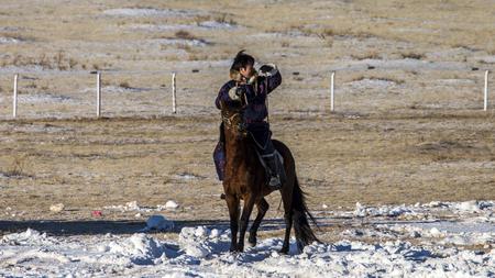 The winter festival venue staff patrol on horseback Stok Fotoğraf - 86347061