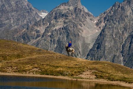 Man riding horse near the lake