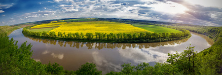 Panoramic view from the hill on bend of the river.Colorful pink sky of the morning. Dniester Canyon located at the territory of Dniester River Valley in Ukraine. Zdjęcie Seryjne