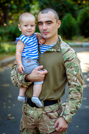 Ukraine, Khmelnitsky. August 30, 2015. A Ukrainian soldier with a small son.