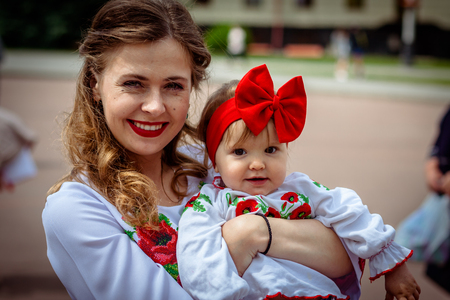 Khmelnitsky, Ukraine - May 17, 2018. A girl with a small child in traditional Ukrainian clothes at the Parade of Vyshyvanka.