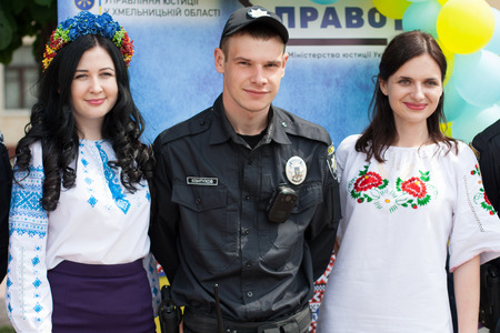 Khmelnitsky, Ukraine - May 17, 2018. A girls  and the policeman in traditional Ukrainian clothes at the Parade of Vyshyvanka. Editorial