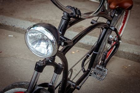 headlight  on the frame of the bike.