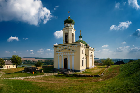 Photo of ancient Khotyn church near the castle in Ukraine at the day time in summer. Foto de archivo