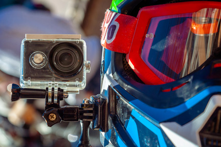 Action camera on a motorcycle riders helmet Stock Photo