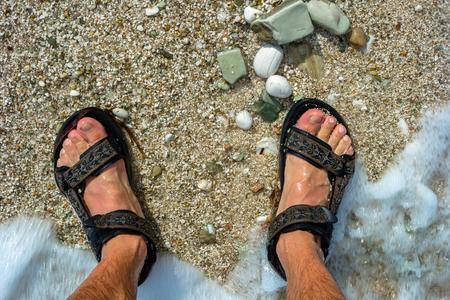 Feet on the beach in the waves. Albania Reklamní fotografie