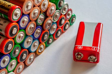Closeup of pile of used alkaline batteries. Several  in rows. Foto de archivo