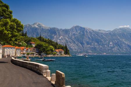 Sunny Mediterranean landscape. Montenegro, Bay of Kotor. 免版税图像