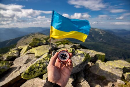 The flag of Ukraine on top of the Carpathian mountains. Beautiful mountain landscape.