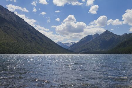 Multinsky lakes in Altai mountains. Picturesque landscape with white clouds. Summer.