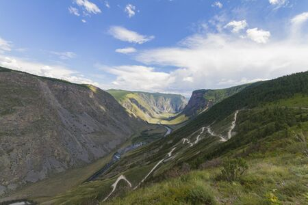 Valley of the river, top view. Altay mountains. Summer sunny day. Mountain car pass