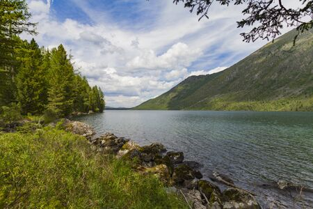 Multinsky lakes in Altai mountains. Picturesque shore with blue water. Summer concept.