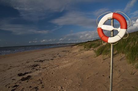 Life Saver on the Beach under a Blue Sky  photo