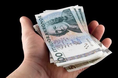 Human hand holding swedish money  Swedish currency  Stock Photo