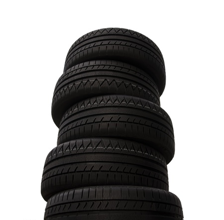 Brand new Winter tires stacked up and isolated on white background
