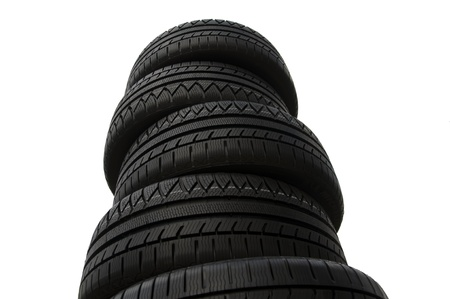 Brand new Winter tires stacked up and isolated on white background  photo
