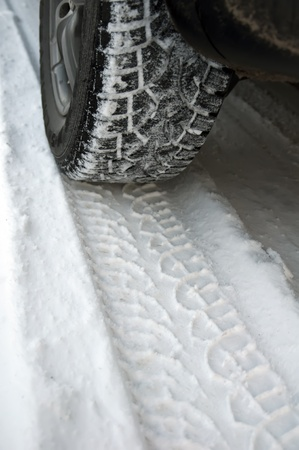 Tire trace on snow Stock Photo