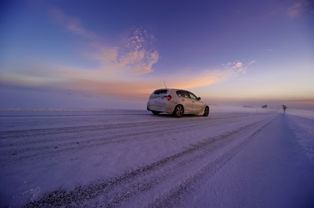 Snowy land road at winter and  car, deep blue sky