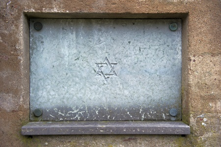 Star of David engraved in stone - symbol of Judaism  photo