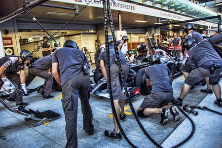 Sochi Autodrom. Grand Prix of Russia. Formula One  Sauber Race Car pitstop – team mechanics.: Esteban Manuel Gutiérrez Gutiérrez race car in paddock. Photo taken on:    October 9th, 2014