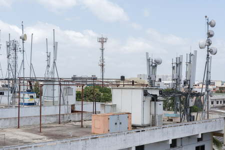 radio unit: Cellular communications tower on a roof.