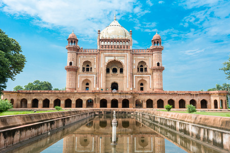 Birds flying over Safdar Jungs Tomb, Delhi, India. Safdarjungs Tomb is a sandstone and marble mausoleum. It was built in 1754 in the late Mughal Empire style for the statesman Safdarjung.