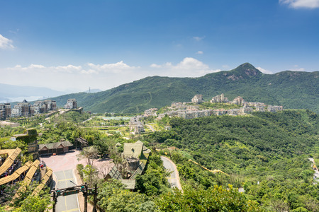 Modern castle against the mountains in Overseas Chinese Town (OCT) of Shenzhen, China Editorial