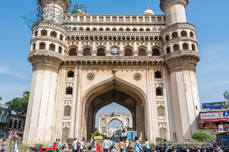 Hyderabad City, Andhra Pradesh, India- November 18, 2016: Pedestrians walking at the street of Hyderabad with background of Charminar, which is a monument and mosque constructed in 1591.