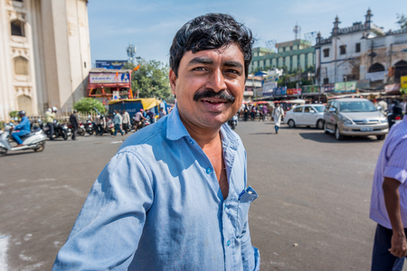 Hyderabad City, Andhra Pradesh, India- November 18, 2016: Portrait of Indian man with mustache in front of Charminar in Hyderabad Editorial