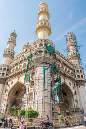 Hyderabad City, Andhra Pradesh, India- November 18, 2016: Pedestrians walking at the street of Hyderabad with background of Charminar, which is a monument and mosque,constructed in 1591